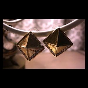 Gold pyramid statement earrings.